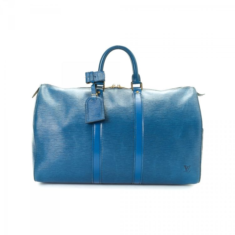 c889256112cf LXRandCo guarantees this is an authentic vintage Louis Vuitton Keepall 45 travel  bag. This iconic luggage was crafted in epi leather in beautiful blue.