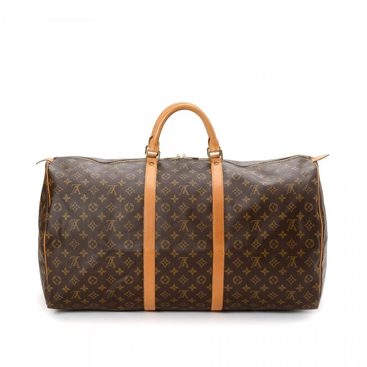 8aa1685e733b LXRandCo guarantees this is an authentic vintage Louis Vuitton Keepall 60  travel bag. Crafted in monogram coated canvas