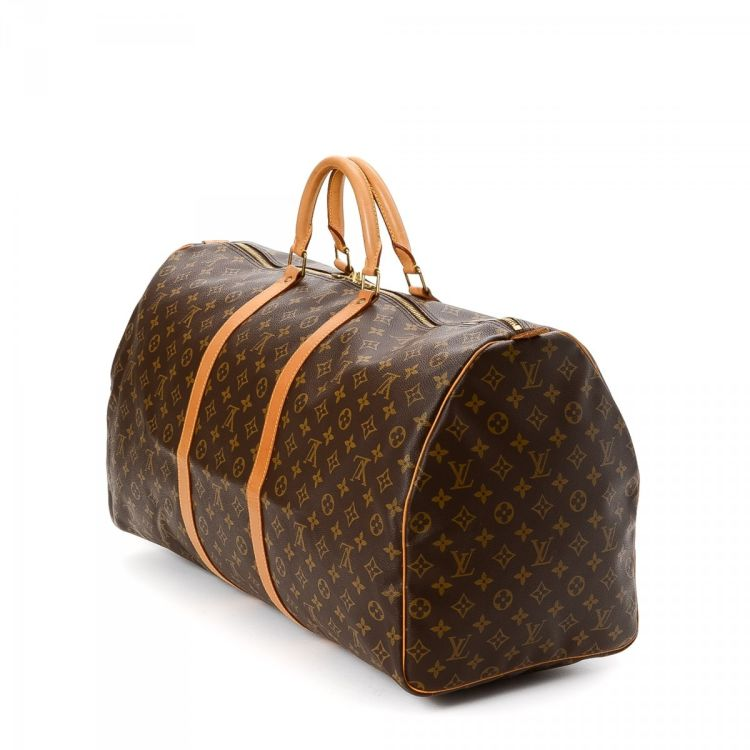 96fa694b936a LXRandCo guarantees this is an authentic vintage Louis Vuitton Keepall 60  travel bag. Crafted in monogram coated canvas