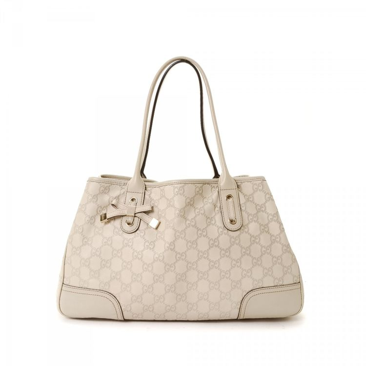 ddea80a648710a LXRandCo guarantees the authenticity of this vintage Gucci Bag tote. This  signature bag was crafted in gg leather in ivory. Due to the vintage nature  of ...