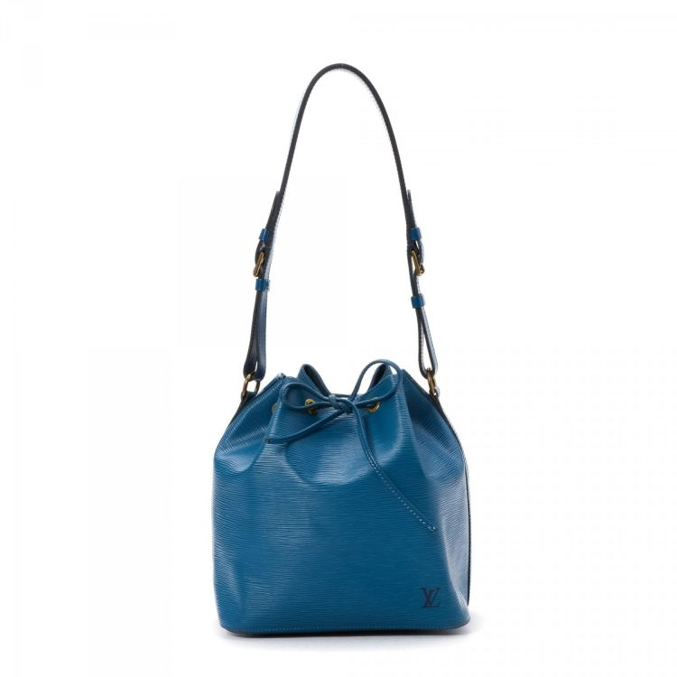 edb964420b51 LXRandCo guarantees the authenticity of this vintage Louis Vuitton Petit Noe  shoulder bag. This iconic shoulder bag comes in luxurious leather.