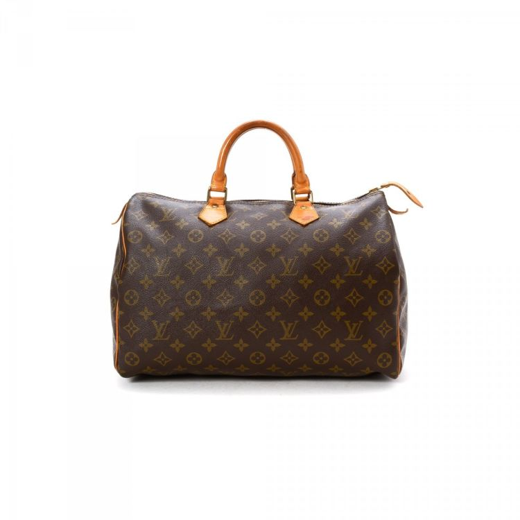 7ac5081fbb1b LXRandCo guarantees the authenticity of this vintage Louis Vuitton Speedy 35  travel bag. This refined boston bag comes in elegant coated canvas.