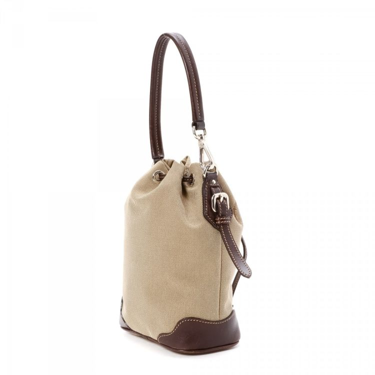 fc5628013d67 ... this vintage Prada handbag. This beautiful handbag in beige is made of  canvas. Due to the vintage nature of this product, signs of wear on leather  trim, ...