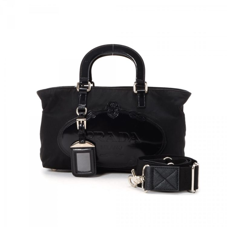 513cc26242a2 The authenticity of this vintage Prada Tessuto Two Way handbag is  guaranteed by LXRandCo. This chic bag was crafted in nylon in black.