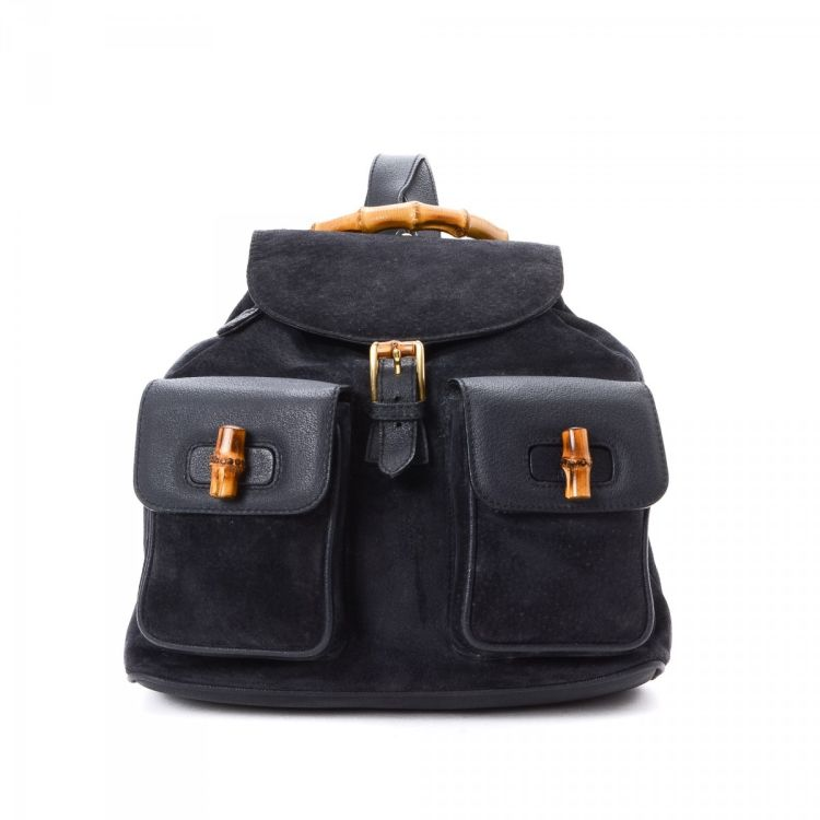 1c0dfdf2e30 The authenticity of this vintage Gucci Bamboo backpack is guaranteed by  LXRandCo. Crafted in suede