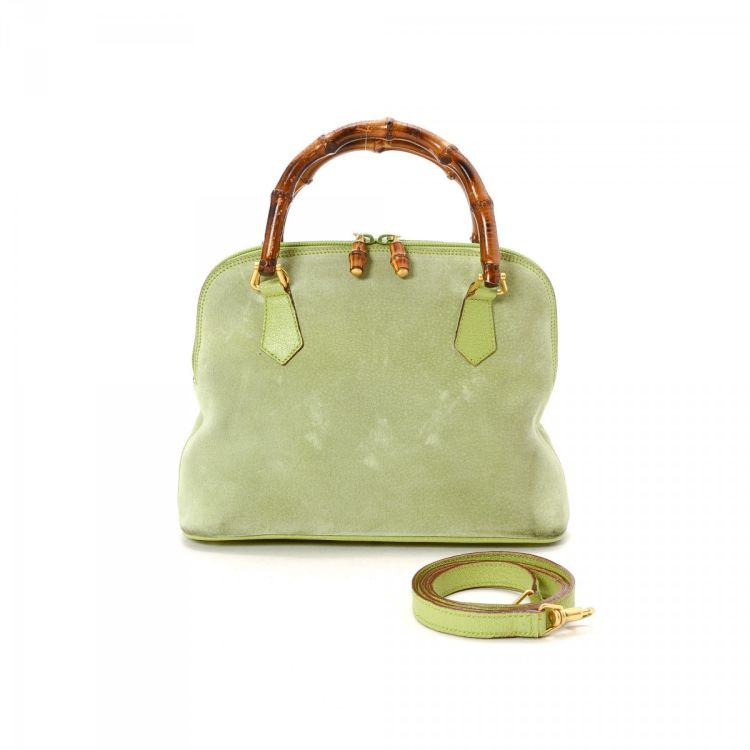 7188d61f0200 The authenticity of this vintage Gucci Bamboo Two Way Bag handbag is  guaranteed by LXRandCo. This beautiful pocketbook comes in lime green suede.