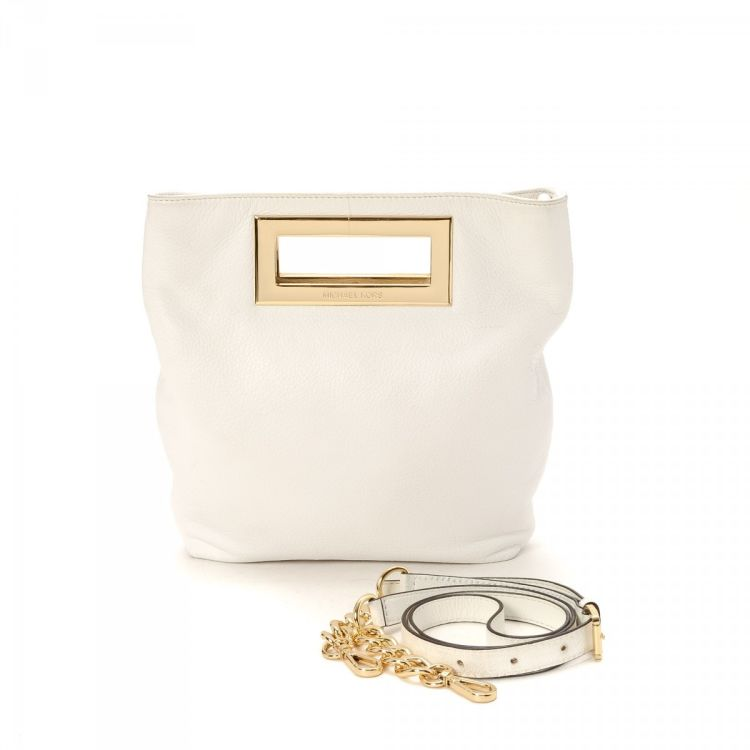 d312394d13e6 LXRandCo guarantees this is an authentic vintage Michael Kors Crossbody Bag  messenger & crossbody bag. This sophisticated hobo bag comes in leather.