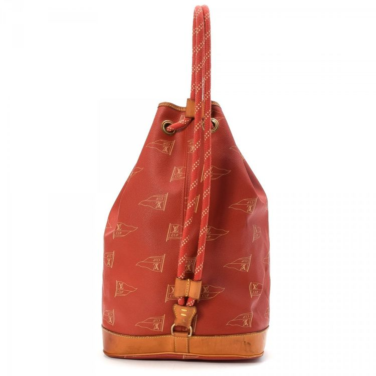 LXRandCo guarantees the authenticity of this vintage Louis Vuitton Saint  Tropez America s Cup shoulder bag. This stylish pocketbook in red is made  of ... fbc57d374f7