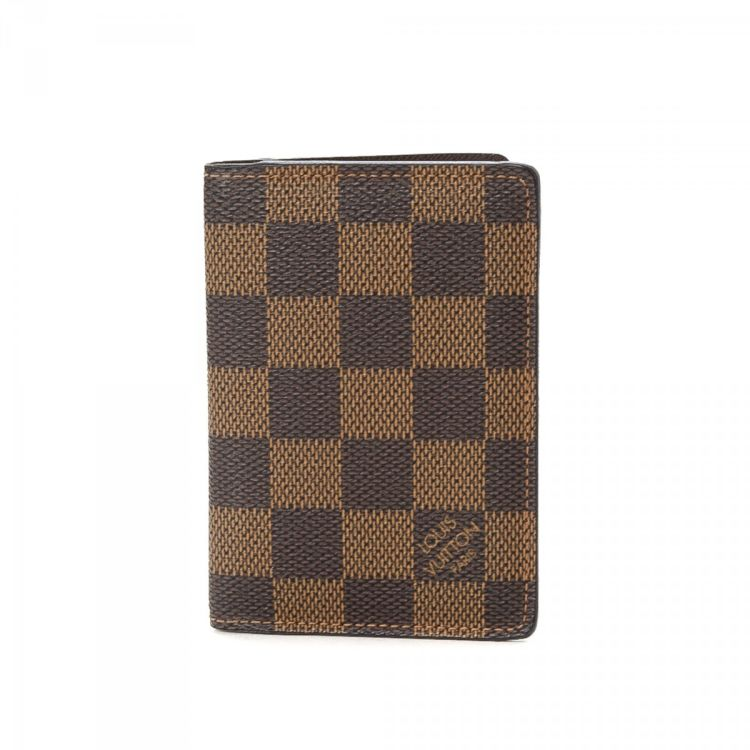 The authenticity of this vintage Louis Vuitton Pocket Organizer wallet is  guaranteed by LXRandCo. This refined billfold in beautiful brown is made in  damier ... 33140c6ec9
