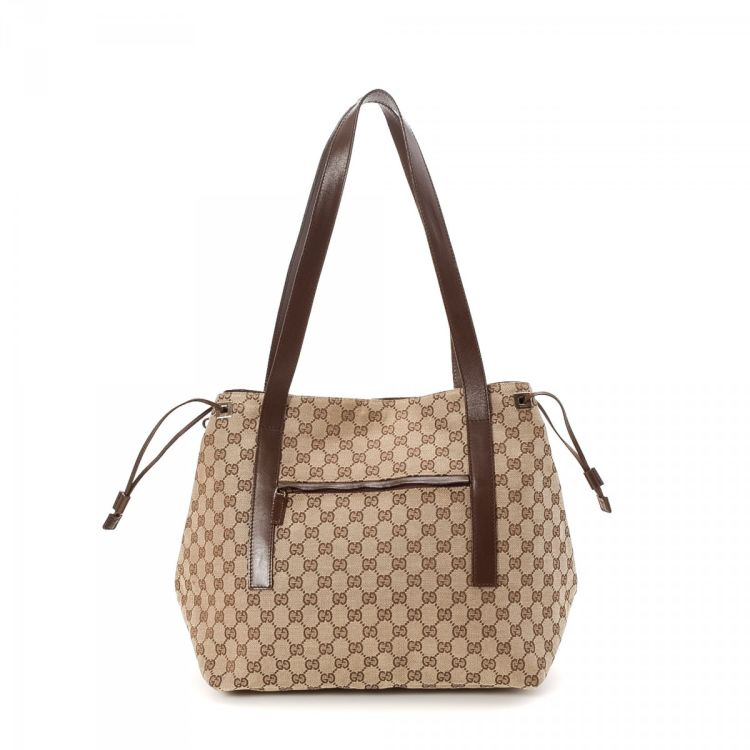 b1a47f4425b LXRandCo guarantees this is an authentic vintage Gucci tote. This exquisite  work bag was crafted in gg canvas in beautiful beige. Due to the vintage  nature ...