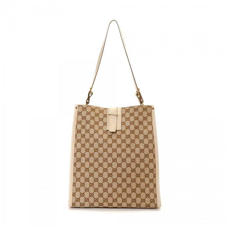 c1dfcb5c8d6 LXRandCo guarantees the authenticity of this vintage Gucci Bag tote. This  refined work bag in beautiful beige is made in gg canvas.