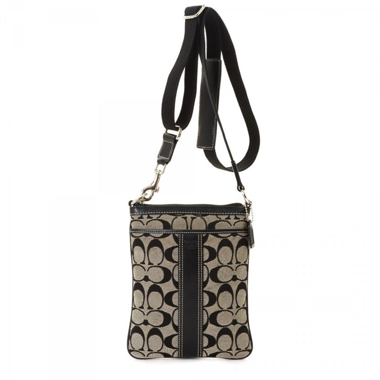 b4e6a277a This lovely messenger & crossbody bag in black is made of canvas. Good  condition* (AB)