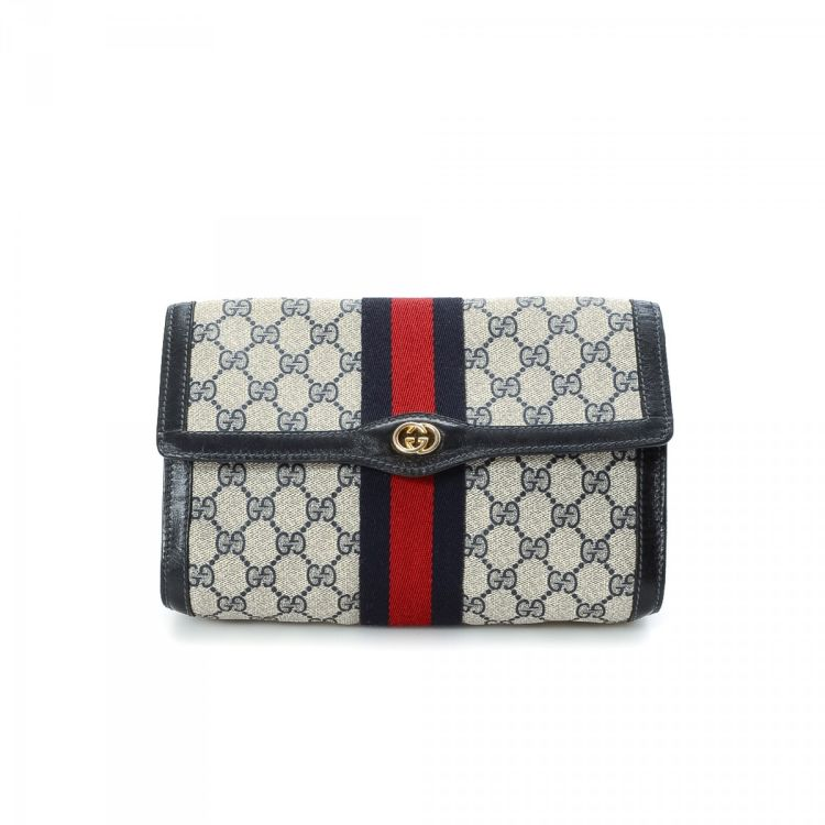 726ae8b8085 ... guarantees the authenticity of this vintage Gucci Clutch Bag vanity case    pouch. This stylish makeup case was crafted in gg canvas in beautiful blue .