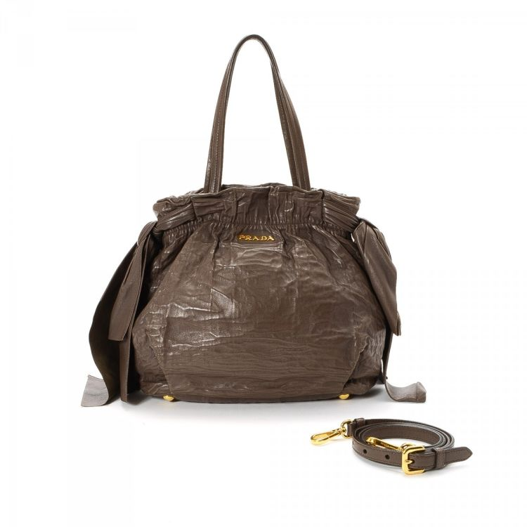 b1c49947fd60 The authenticity of this vintage Prada Two Way Bag shoulder bag is  guaranteed by LXRandCo. Crafted in leather, this classic purse comes in  brown.