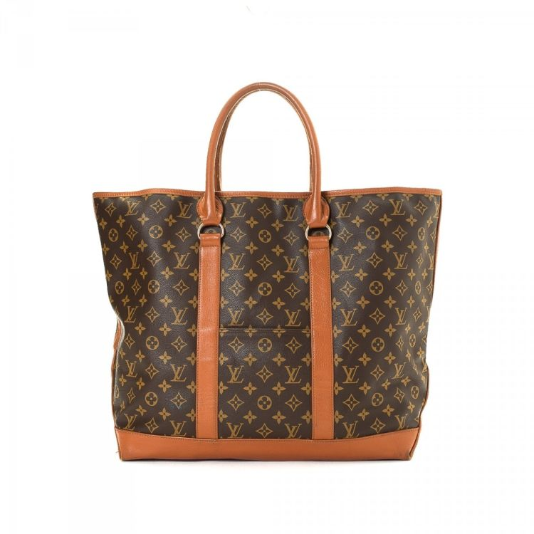 36cd2b82854c LXRandCo guarantees this is an authentic vintage Louis Vuitton Sac Weekend  GM tote. Crafted in monogram coated canvas