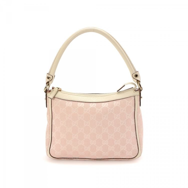 be50eac3a3e The authenticity of this vintage Gucci handbag is guaranteed by LXRandCo.  This signature bag was crafted in gg canvas in baby pink. Good condition   (AB)