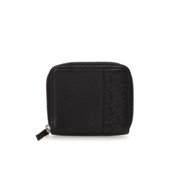 8ed2f45c983f26 LXRandCo guarantees this is an authentic vintage Gucci Coin Purse wallet.  This sophisticated card case was crafted in guccissima leather in black.