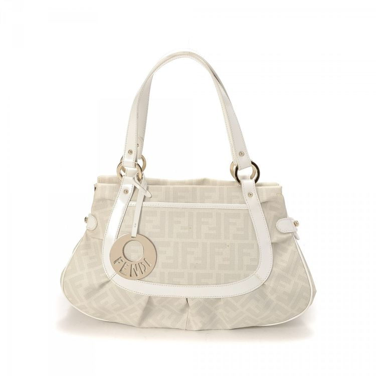 3699f727000 LXRandCo guarantees the authenticity of this vintage Fendi handbag. This  exquisite bag was crafted in zucca canvas in white. Due to the vintage  nature of ...