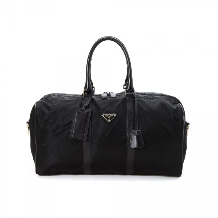 119f3589ac3646 LXRandCo guarantees the authenticity of this vintage Prada Tessuto Boston  Bag travel bag. Crafted in nylon, this lovely travel bag comes in black.