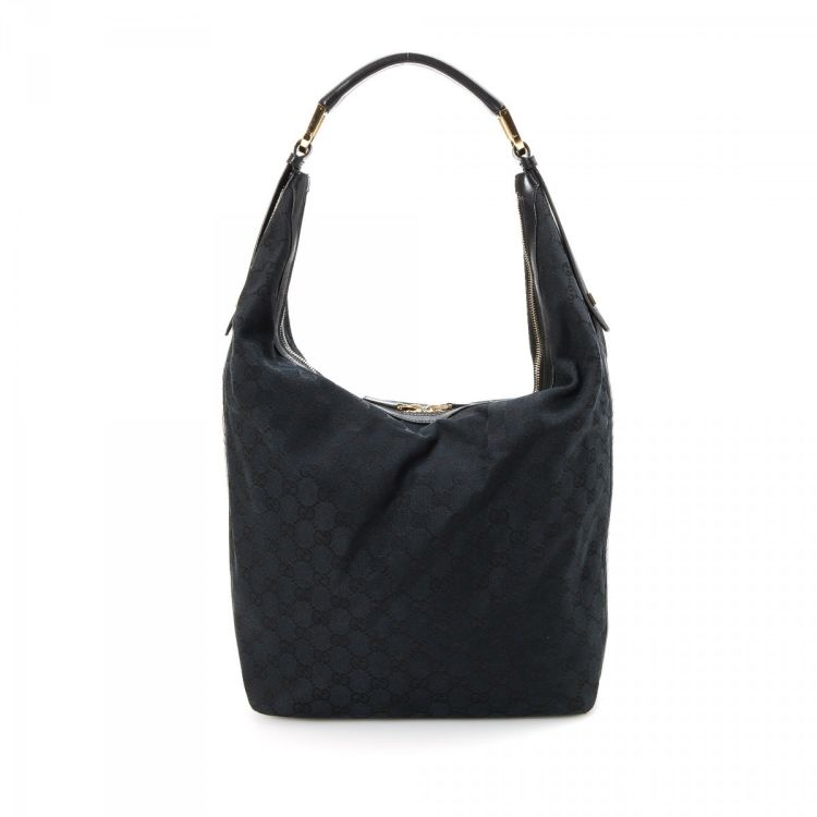 2ad263b38f4 LXRandCo guarantees the authenticity of this vintage Gucci Hobo Bag  shoulder bag. Crafted in gg canvas