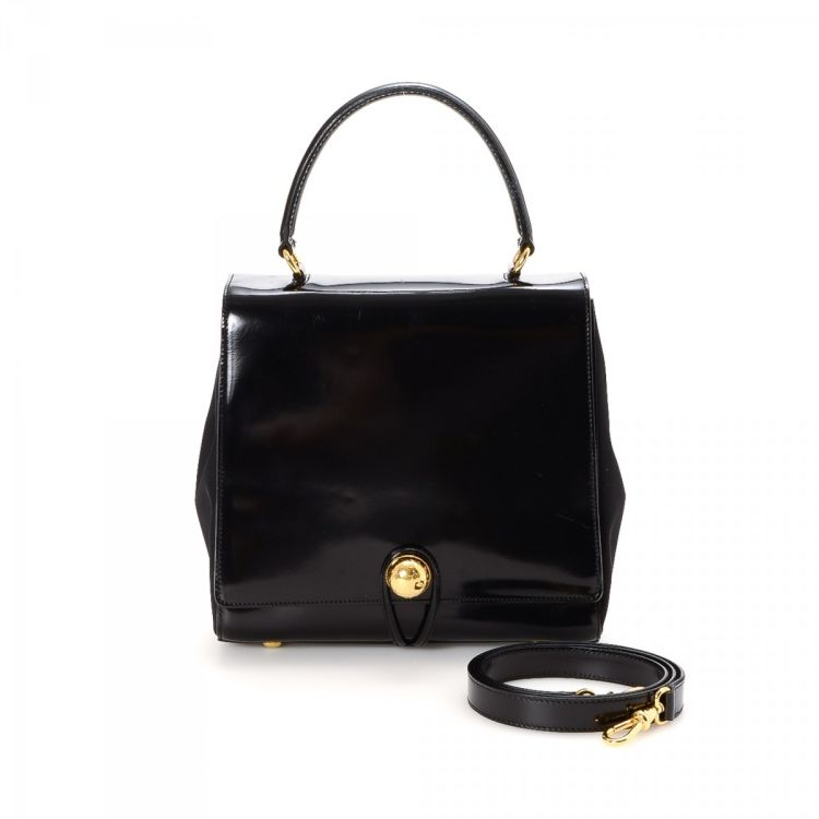 1b290d644b851 LXRandCo guarantees this is an authentic vintage Céline Two Way Bag handbag.  Crafted in leather