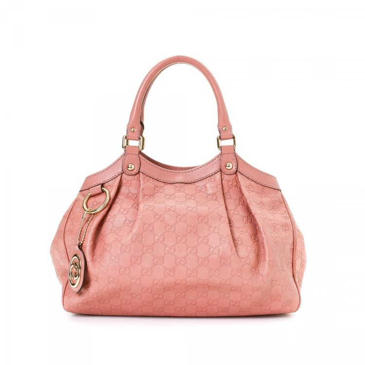 7bb7454205420c LXRandCo guarantees this is an authentic vintage Gucci Sukey Medium tote.  This luxurious large handbag was crafted in guccissima leather in beautiful  pink.