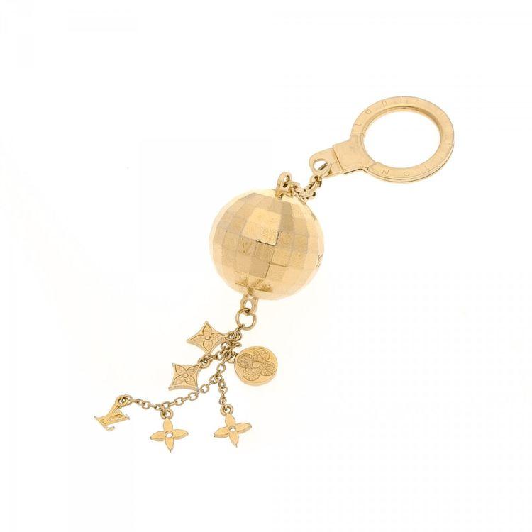 ccc412175cb8 LXRandCo guarantees the authenticity of this vintage Louis Vuitton Disco  Ball Key Chain Bag Charm. This sophisticated accessory in gold tone is made  of gold ...