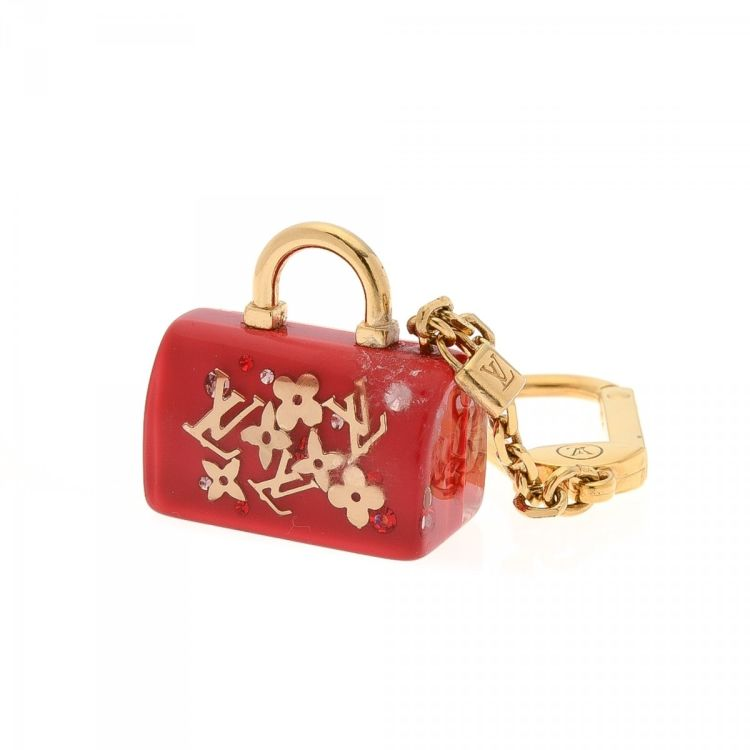 1beada08d2ed LXRandCo guarantees this is an authentic vintage Louis Vuitton Inclusion  Speedy Key Chain or Bag Charm. Crafted in monogram inclusion resin