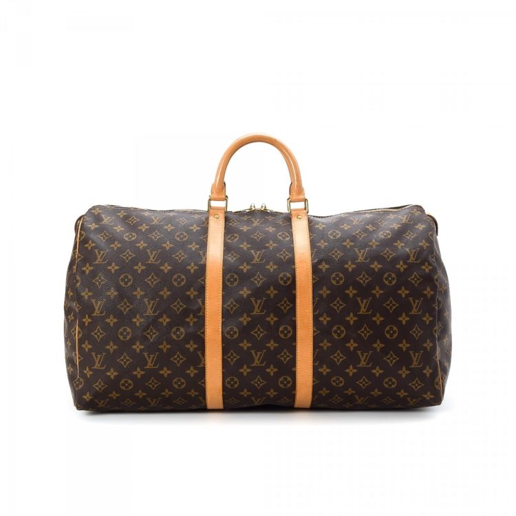 6268f4bea0e5 The authenticity of this vintage Louis Vuitton Keepall 55 travel bag is  guaranteed by LXRandCo. Crafted in monogram coated canvas