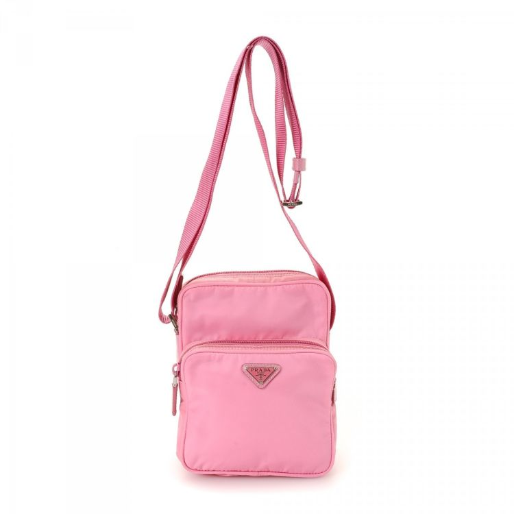 6119869a31c5 ... authentic vintage Prada Tessuto Crossbody Bag messenger & crossbody bag.  This iconic messenger & crossbody bag was crafted in nylon in beautiful pink .