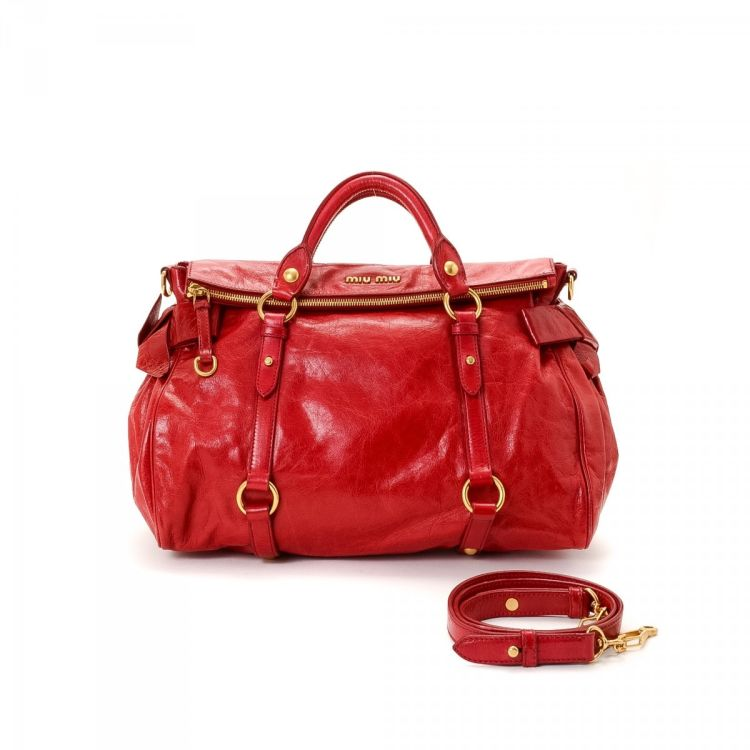 LXRandCo guarantees this is an authentic vintage Miu Miu Two Way Bag  shoulder bag. This elegant purse comes in beautiful red calf. Due to the  vintage nature ... 8b1d3b688af6b