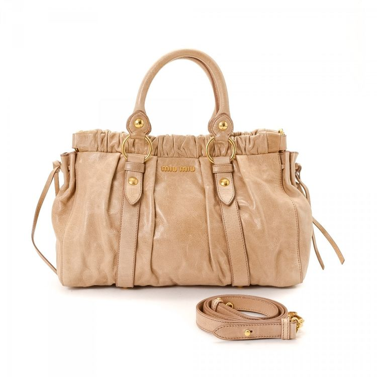 375e6ee34d44 The authenticity of this vintage Miu Miu Two Way Bag shoulder bag is  guaranteed by LXRandCo. This signature pocketbook was crafted in calf in  beige.