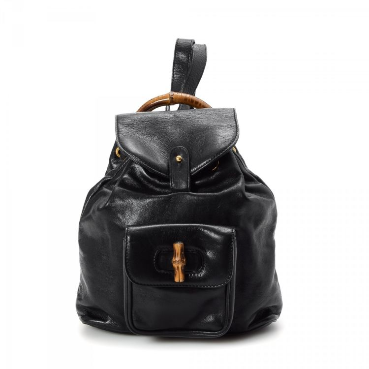 998e401246 LXRandCo guarantees this is an authentic vintage Gucci Small Bamboo backpack.  This stylish pack in beautiful black is made of leather.