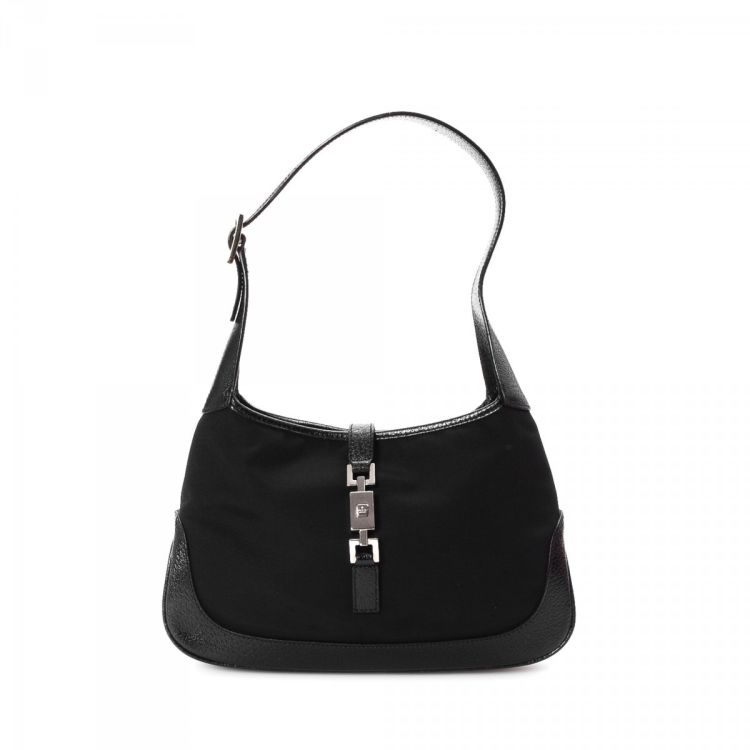 508b89fb5a434c The authenticity of this vintage Gucci Small Jackie shoulder bag is  guaranteed by LXRandCo. This luxurious purse in beautiful black is made of  canvas.