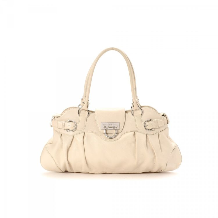 df777c16f32d LXRandCo guarantees this is an authentic vintage Ferragamo Marisa handbag.  This beautiful pocketbook in cream is made of leather. Good condition  (AB)