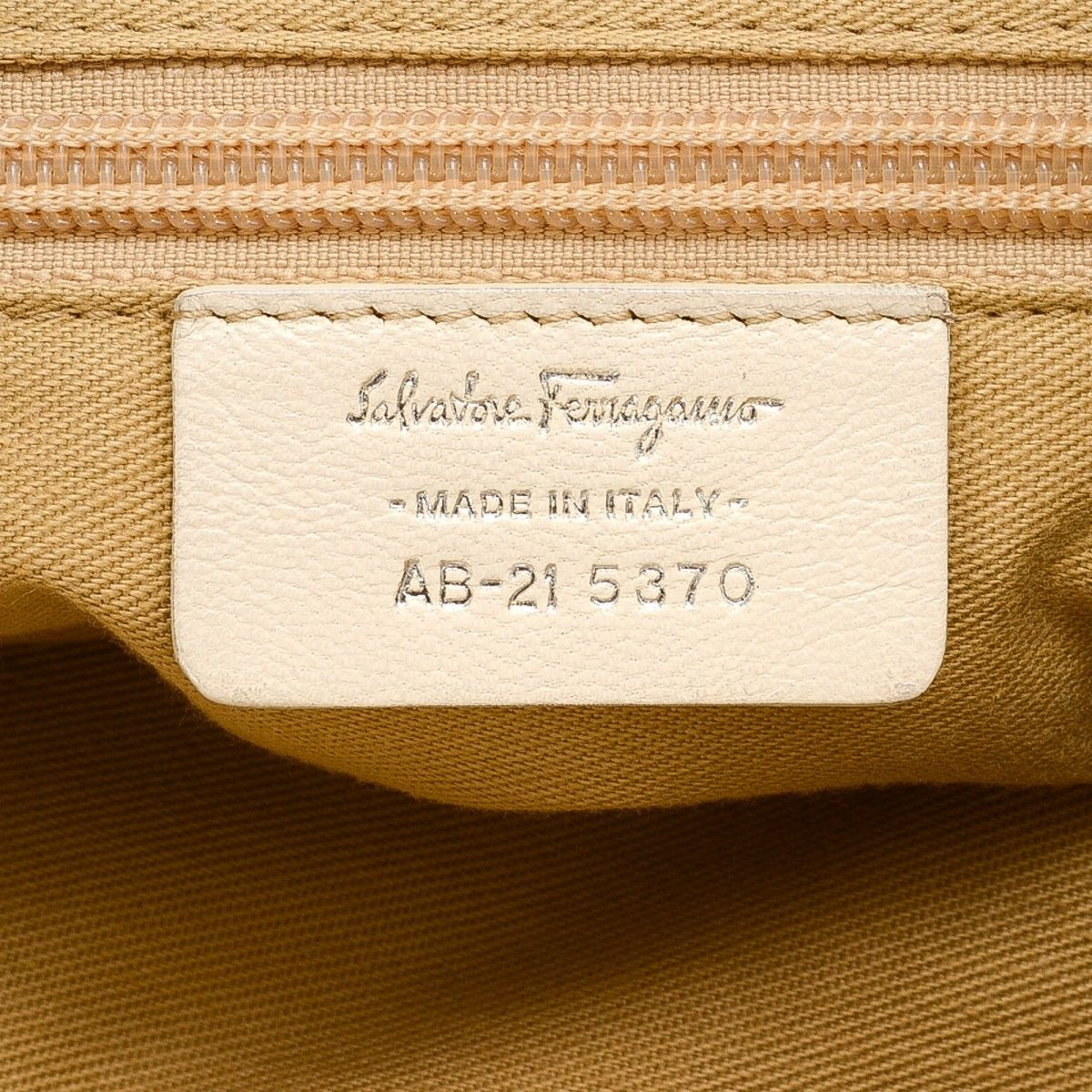 666f96ca1685 Marisa. Free Shipping. LXRandCo guarantees this is an authentic vintage  Ferragamo Marisa handbag. This beautiful pocketbook in cream is made of  leather.
