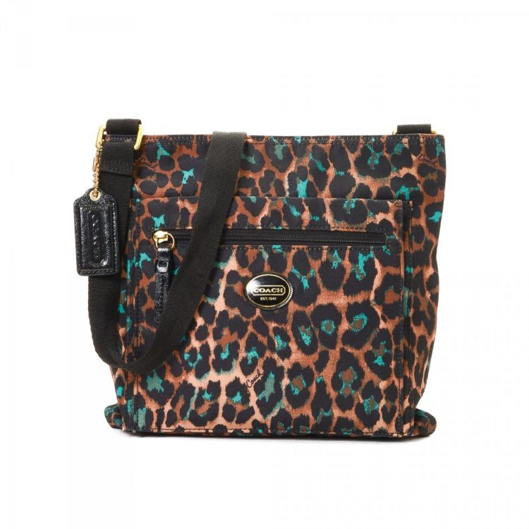 c66608cbd18a LXRandCo guarantees the authenticity of this vintage Coach Leopard  Crossbody Bag messenger & crossbody bag. This iconic pocketbook was crafted  in fabric in ...