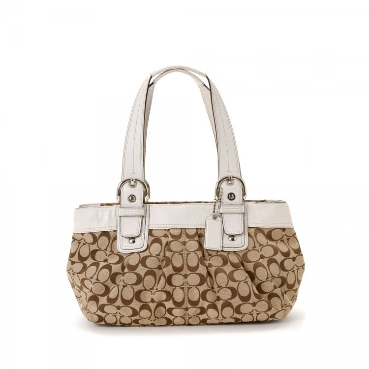 e93adcb931d7a LXRandCo guarantees the authenticity of this vintage Coach tote. This  exquisite tote bag comes in beige canvas. Due to the vintage nature of this  product