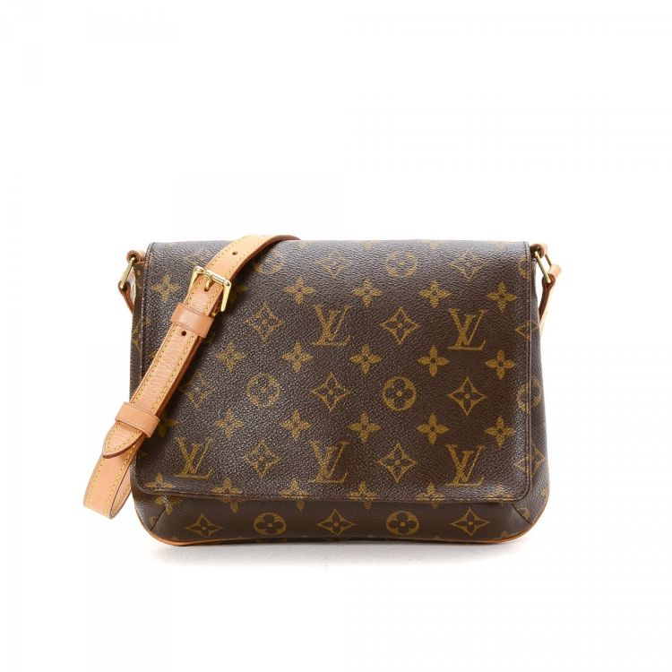 48afa8d00603 LXRandCo guarantees this is an authentic vintage Louis Vuitton Musette  Tango Long Strap messenger   crossbody bag. Crafted in monogram coated  canvas