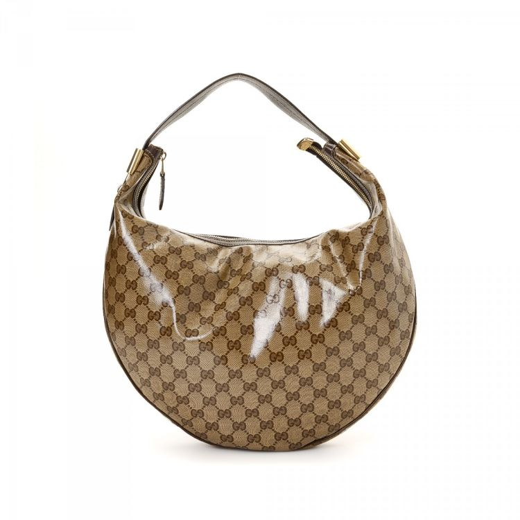 c2dd17f01fe LXRandCo guarantees the authenticity of this vintage Gucci Duchessa Hobo Bag  shoulder bag. Crafted in gg patent leather