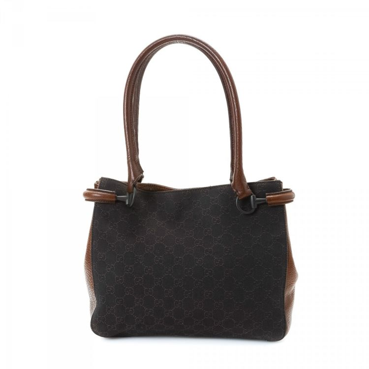 88877ddfc0a720 The authenticity of this vintage Gucci Tote shoulder bag is guaranteed by  LXRandCo. This lovely purse in brown is made in gg canvas.