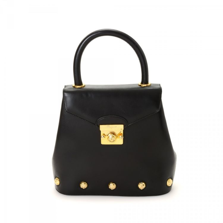 5abda112152c LXRandCo guarantees the authenticity of this vintage Ferragamo Top Handle  Bag handbag. This chic pocketbook was crafted in leather in black.