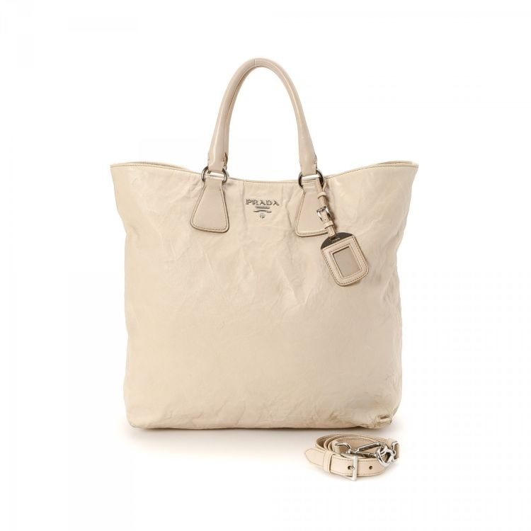 e03886f0061f LXRandCo guarantees this is an authentic vintage Prada Two Way Bag tote.  This signature work bag comes in ivory leather. Good condition* (AB)