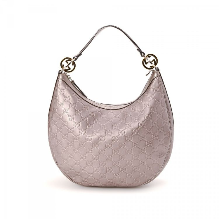 a52b957042dd80 LXRandCo guarantees this is an authentic vintage Gucci Hobo Bag shoulder bag.  This signature purse in lilac is made in guccissima leather.