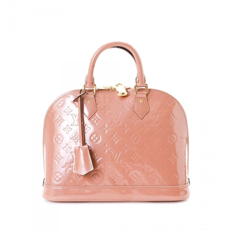 75d3e89ffac8 The authenticity of this vintage Louis Vuitton Alma handbag is guaranteed  by LXRandCo. This exquisite handbag in baby pink is made in vernis patent  leather.