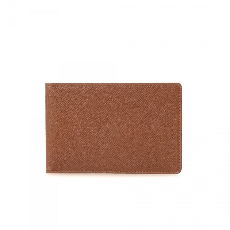 97514ea7b59b LXRandCo guarantees the authenticity of this vintage Louis Vuitton Two ID Card  Holder wallet. This classic bifold was crafted in taiga leather in brown.