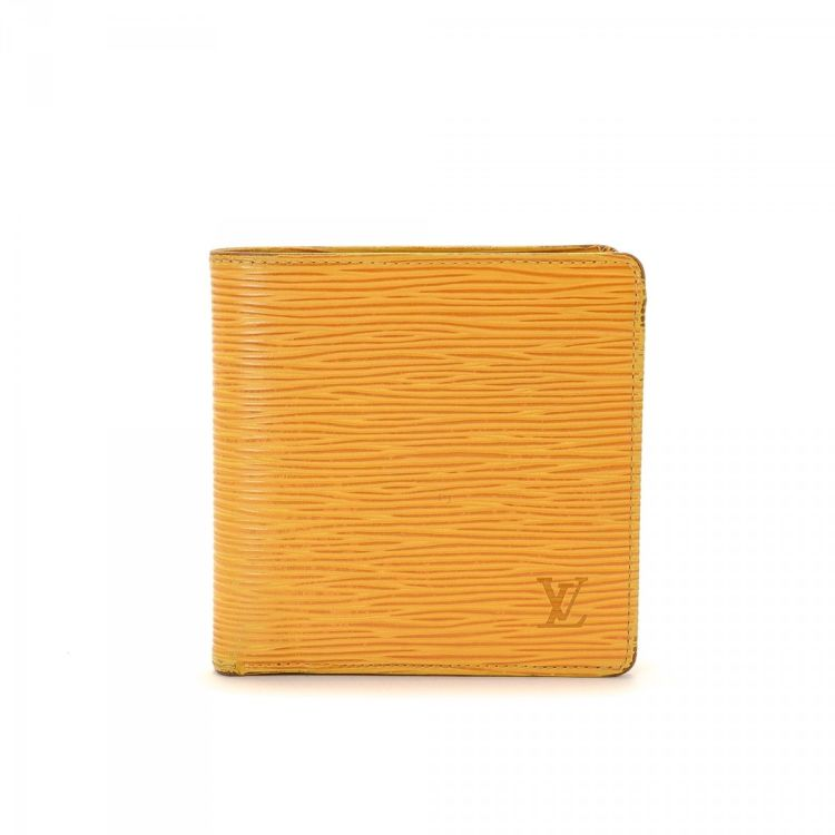 7ea5e238ce83 The authenticity of this vintage Louis Vuitton Marco wallet is guaranteed  by LXRandCo. This stylish compact wallet was crafted in epi leather in  tassil ...