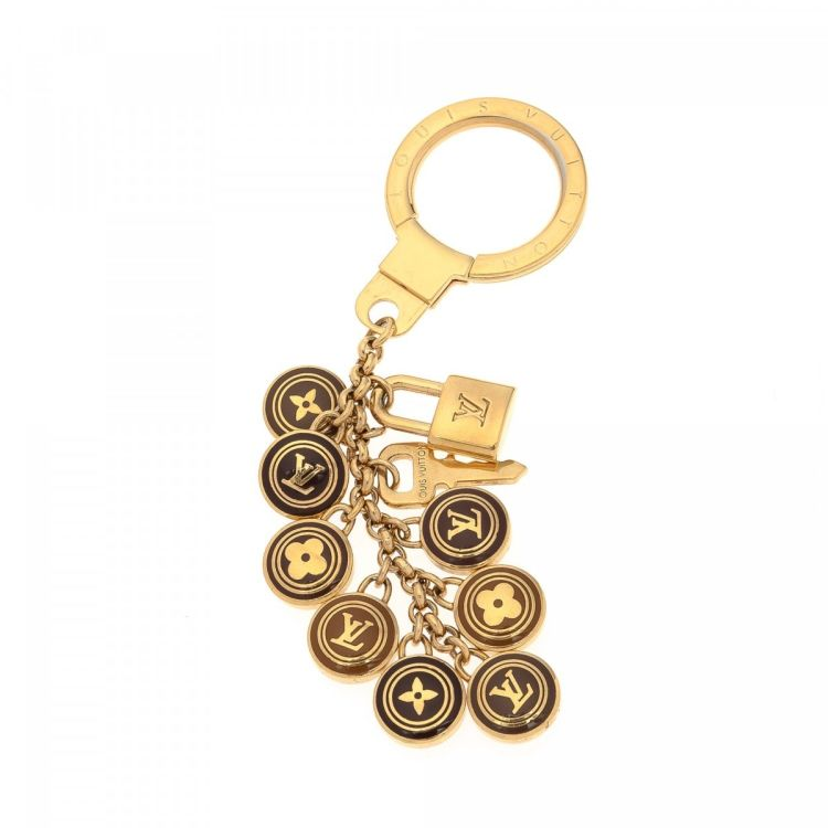 893b3c419d5 LXRandCo guarantees this is an authentic vintage Louis Vuitton Key Chain  other jewelry. This sophisticated jewelry in beautiful gold tone is made of  brass.