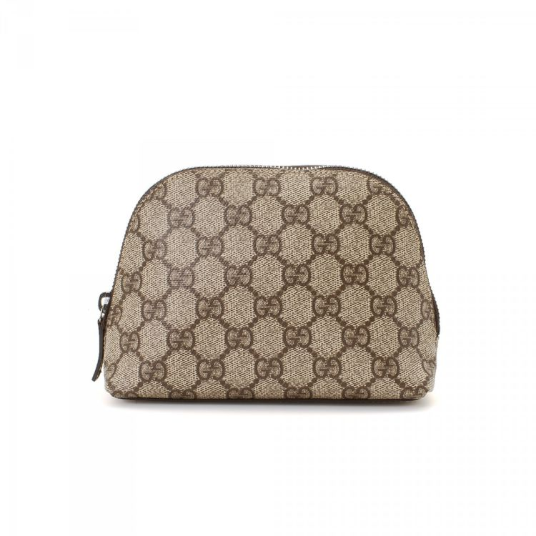 7b2e8f91a26999 LXRandCo guarantees the authenticity of this vintage Gucci Cosmetic Pouch  vanity case & pouch. This exquisite makeup case in beige is made in gg  canvas.
