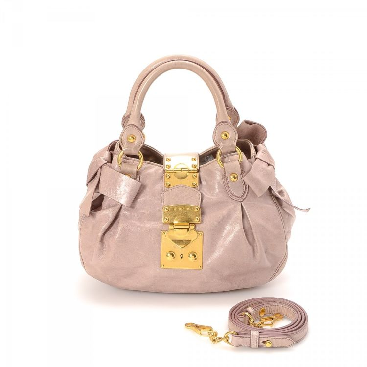 LXRandCo guarantees the authenticity of this vintage Miu Miu Two Way Bow Bag  handbag. This luxurious purse in beautiful rose ballerine is made of  leather. a9a353cb2701c